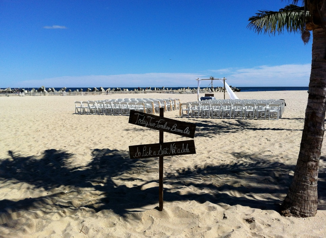 New Jersey Wedding Officiant Andrea Purtell performing a wedding at Jenkinson's Beach Point Pleasant Beach NJ